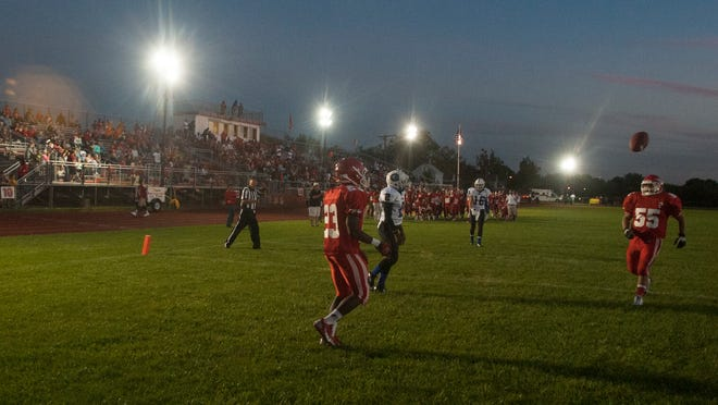 Portable lights are shown on the background at the football field in Paulsboro High school minutes before a game against Gateway.