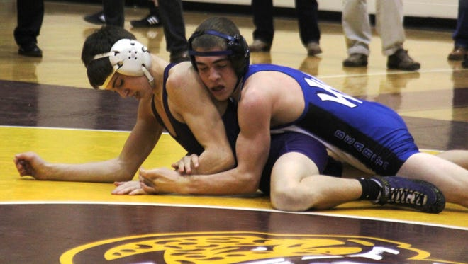 Walton-Verona's Ryan Moore, top, was ranked second in the state at 120 pounds earlier this season.