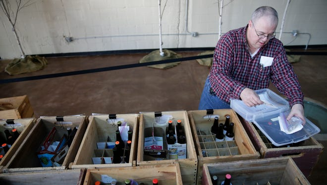 Mike Conard of the Green Bay Rackers sorts entries into their beer contest in the Tap Room of the Titletown Brewery April 22,  2016.