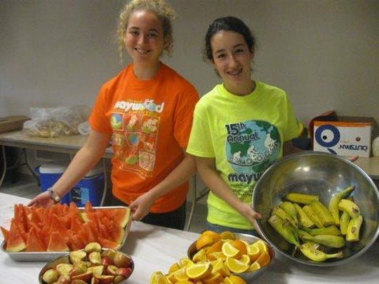 From left, Ali Leonhard and Molly Zenk, volunteer members of the Sheboygan North High Key Club, serve breakfast the Maywood Earth Ride.