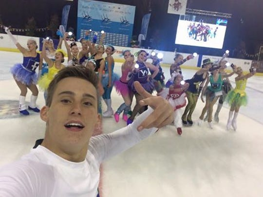 "TJ Nyman, who portrayed ""Google"" in the ""Tribute to Social Media"" free skate performance by members the Space Coast Hurricanes junior Theater on Ice Team, takes a selfie during the final moments of competition at last weekend's Nations Cup competition in Paris, France."