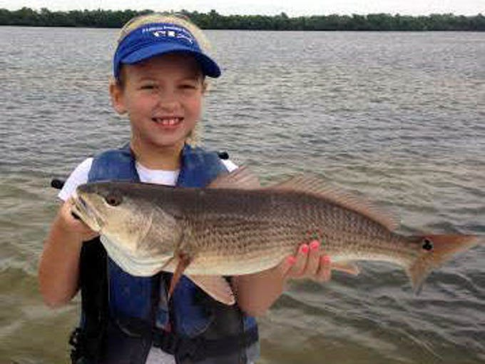 MacKenzie McDowall with a nice redfish she fought and landed Monday in Bull Bay on a rootbeer D.O.A. C.A.L. shad-tail jig scented with Pro-Cure shrimp scent, fishing with her dad, Florida Inshore Xtreme Charters Capt. Jesse McDowall.