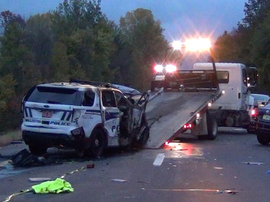 Crews removed a Williston police cruiser early morning