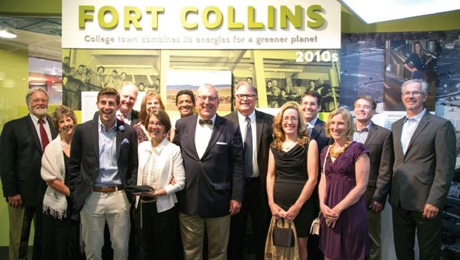 Representatives from CSU and Fort Collins attended a pre-opening event at the Place of Invention exhibit in Washington, D.C., in June (left to right): Robert Haw, Diane Jones, Graeme Troxell, Ed Van Dyne, Gesine Cherian, Jean Troxell, Sunil Cherian, Wade Troxell, Tom Milligan, Judy Dorsey, Dan Epstein, Julie Zinn, Bryan Willson, Darin Atteberry. Fort Collins is the first place visitors encounter when entering the exhibit.