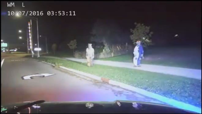 Menasha Police Department dash cam video shows people wearing clown costumes on Oct. 7.