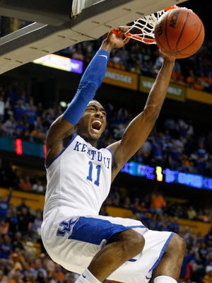 Kentucky's John Wall slams one home to help the Cats defeat Tennessee.  (By Scott Utterback, The Courier-Journal)March 13, 2010