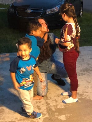 Roxanna Hernandez, center, is reunited with her kids after being released from the Broward Transitional Center, where she'd been taken by ICE after being picked up at the Martin County Jail.