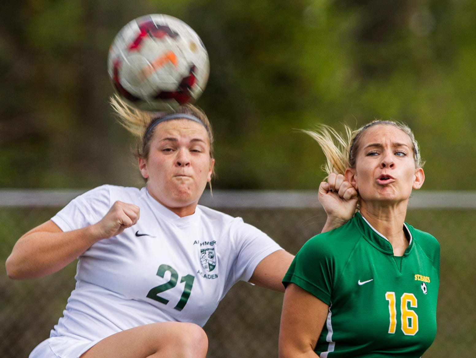 Archmere's Gillian Sweeny (No. 21) collides with St. Mark's Chelsea Vincelette as the ball enters the box during a game at Archmere on Wednesday afternoon. Archmere defeated St. Mark's by a score of 2-1.