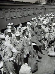 German prisoners of war arrive by train at Camp Shanks