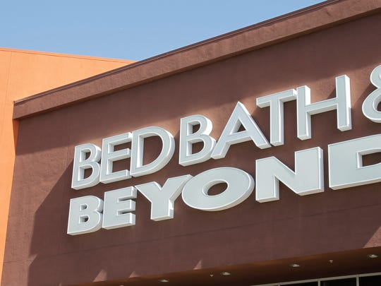 Bed Bath & Beyond has agreed to pay $125,000 as part of a settlement over its policy of disqualifying ex-cons from employment.