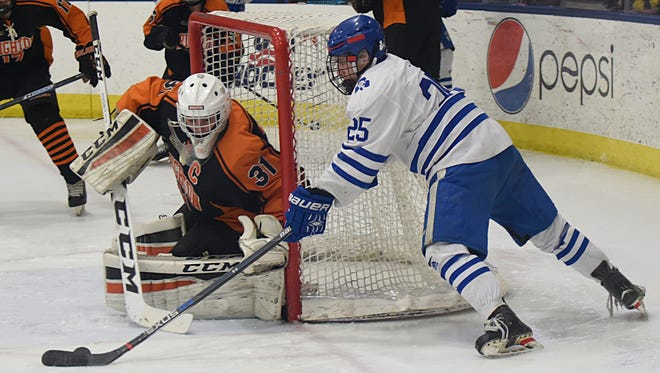 Catholic Central's Brendan West (25), scoring a goal in last year's state final, finished with 41 points on the season.