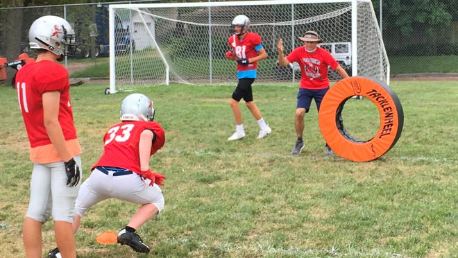 Cair Paravel Latin football coach Doug Bonura puts his team through a drill in a preseason practice. The Lions are off to a 2-0 start after a 58-26 road win over Wichita Home School on Friday night.
