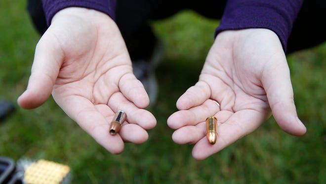 In this Oct. 2015 photo, Florida Students for Concealed Carry executive director Rebekah Hargrove displays the two types of ammo in her kit; a target round on the right and a hollow point on the left at her in-laws house near Lake Miccosukee.