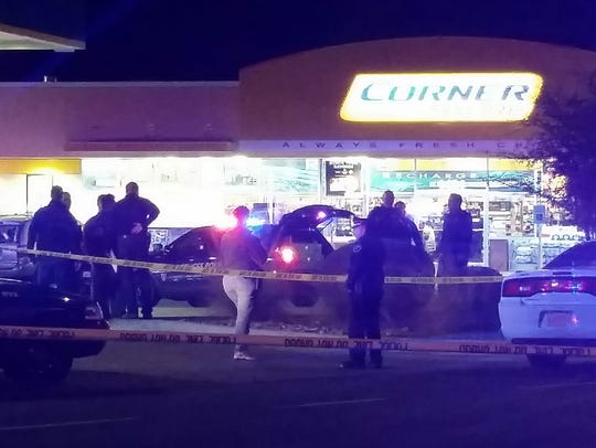 Authorities cordoned off the Valero Corner Store, 1401