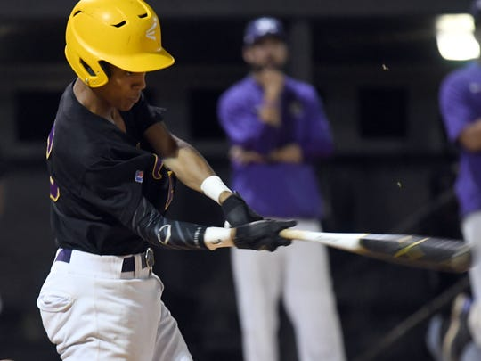 Hattiesburg High's Caleb Tart swings for the ball in