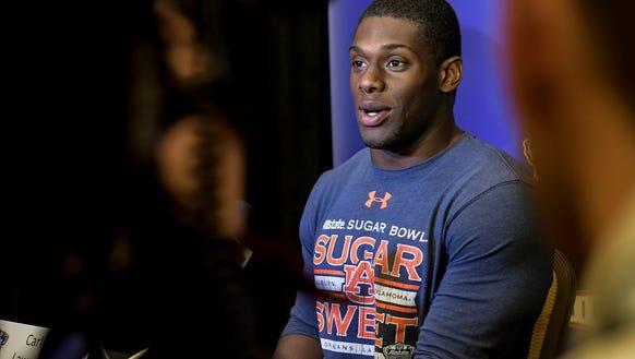 Auburn defensive end Carl Lawson speaks to the media