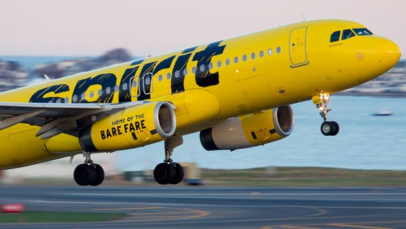 A Spirit Airlines Airbus A320 departs Boston Logan