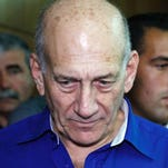 This file photo taken on May 13, 2014 shows former Israeli Prime Minister Ehud Olmert arriving for a hearing in his trial for corruption linked to a major property development at the district court of the Israeli coastal city of Tel Aviv.