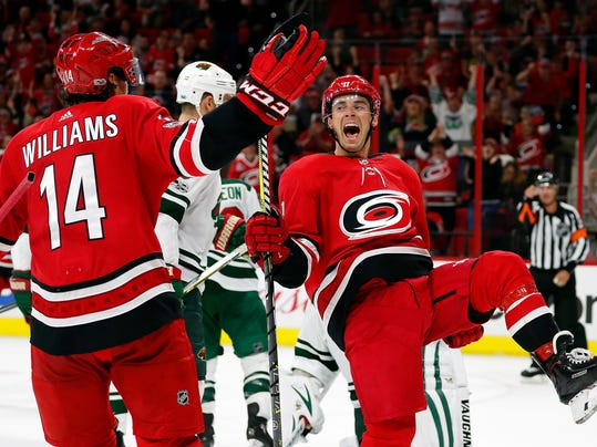 Carolina Hurricanes' Derek Ryan (7) celebrates his goal with teammate Justin Williams (14) during the second period of an NHL hockey game against the Minnesota Wild, Saturday, Oct. 7, 2017, in Raleigh, N.C. (AP Photo/Karl B DeBlaker)