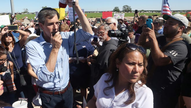 U.S. Rep. Beto O'Rourke, D-El Paso, speaks to the crowd before starting on a short march to the entrance gate to the Tornillo-Guadalupe port of entry June 17 east of El Paso. At right is former County Judge Veronica Escobar, who is the Democratic Party candidate running to fill O'Rourke's congressional seat. O'Rourke is running for the U.S. Senate against Republican U.S. Sen. Ted Cruz.