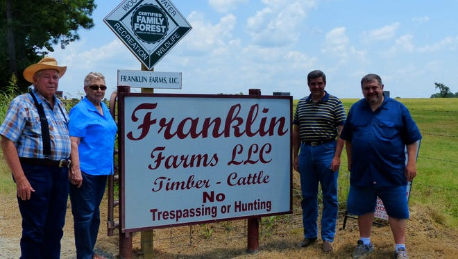 Billy Franklin and his wife, Ottie, and sons John and Cole Franklin.