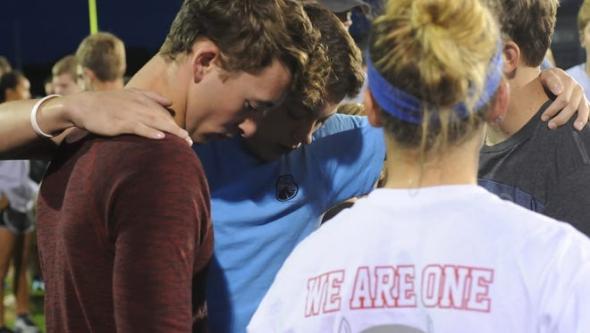 West Lafayette students came together at Gordon Straley Field Tuesday night to mourn the death of Christian Burns, who just finished his junior year at West Lafayette High School.