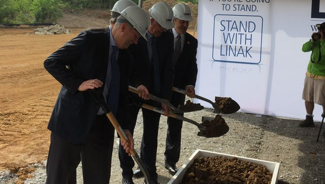 Kentucky Gov. Matt Bevin, far right, with Louisville Mayor Greg Fischer, joined 2 executives of LINAK U.S., a Danish manufacturer of actuators, or motorized extensions, to break ground on a new facility in the 12000 block of LaGrange Road. May 9, 2017
