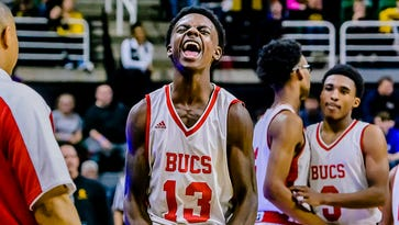 Edrice Hardnett (13) of Flint Beecher roars after checking out of the Class C state championship game between Grand Rapids Covenant Christian and Flint Beecher with his team leading 73-58 with 51.7 seconds remaining in the fourth quarter.