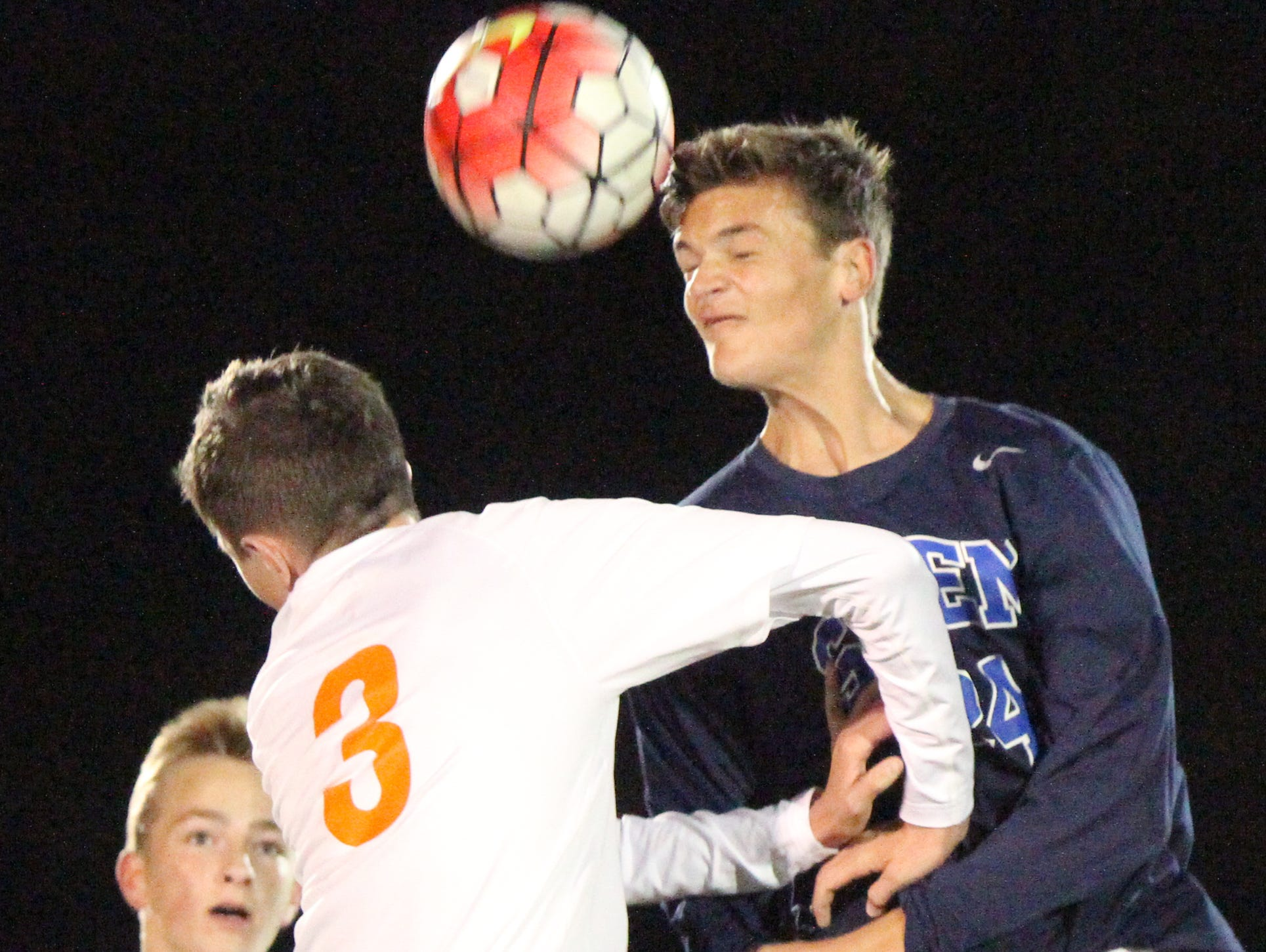 Brighton's Thomas Corrigan, left, and Christian Freitag of Salem jump for a header in a game the Bulldogs lost, 5-0, to Salem on Wednesday night.