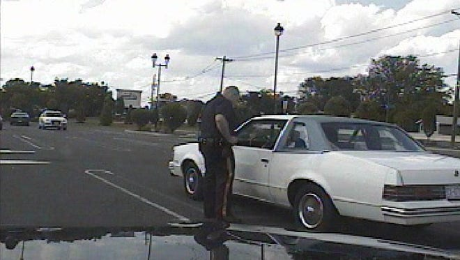 Officer Michael Methner is seen speaking to George Kelly in this still from an East Brunswick dash cam video.