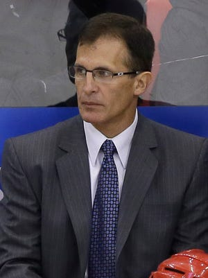 Detroit Red Wings assistant coach Tony Granato looks on against the Chicago Blackhawks on Sept. 25, 2014.