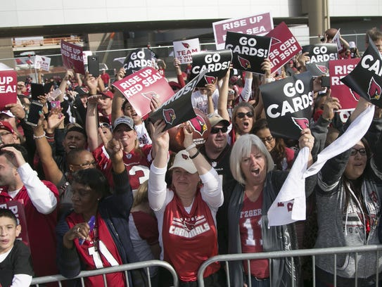 Cardinals fans cheer on the team during the pep rally/send