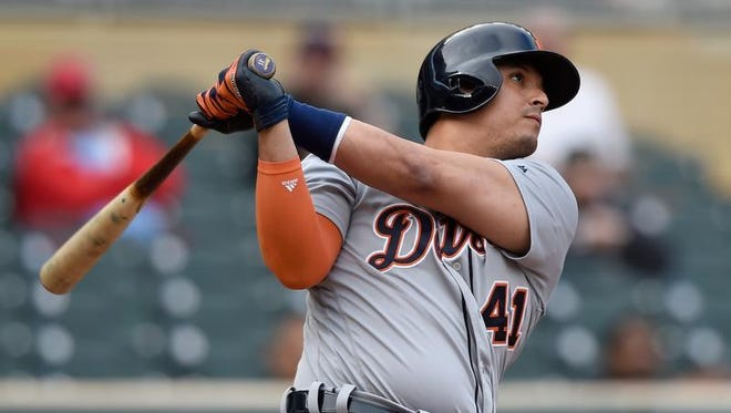 Tigers pinch hitter Victor Martinez hits a three-run homer againsts the Twins during the ninth inning at Target Field on Thursday in Minneapolis.