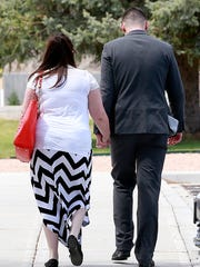 Richard Emmert and his wife leave the courthouse after Judge John Dean declared him not guilty on charges of child rape and molestation on Friday at the 11th Judicial District Court in Aztec.