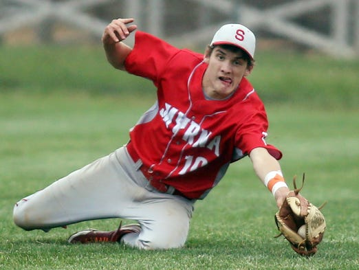 Smyrna left fielder Justin Jones dives to make a catch in the 7th inning of Smyrna's 3-1 win against A.I. du Pont at Smyrna High School, Wednesday, May 14, 2014. The play helped the Eagles to a 1-2-3 final inning while protecting their 2 run lead.