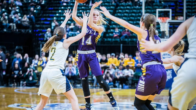Vincennes Rivet's Grace Waggoner looks to pass in the Class A state championship game on Feb. 24 at Bankers Life Fieldhouse.