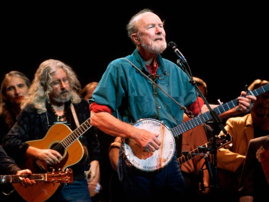 Folk music icon Pete Seeger plays the banjo and sings