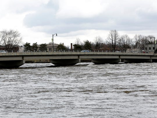 Water from the Wisconsin River rushes up to the foot of the West Grand Avenue Bridge in Wisconsin Rapids March 17, 2016.
