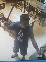 An image of an unidentified man, suspected of robbing