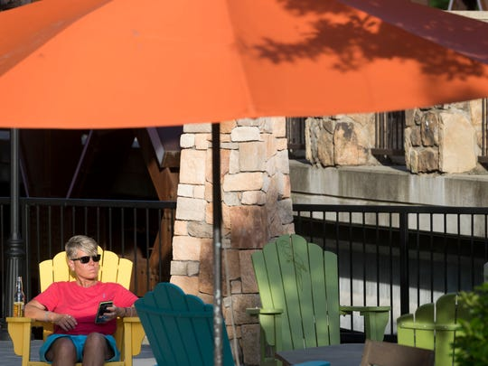 A Pigeon Forge visitor hangs out at the Margaritaville hotel patio on Monday, June 4, 2018.