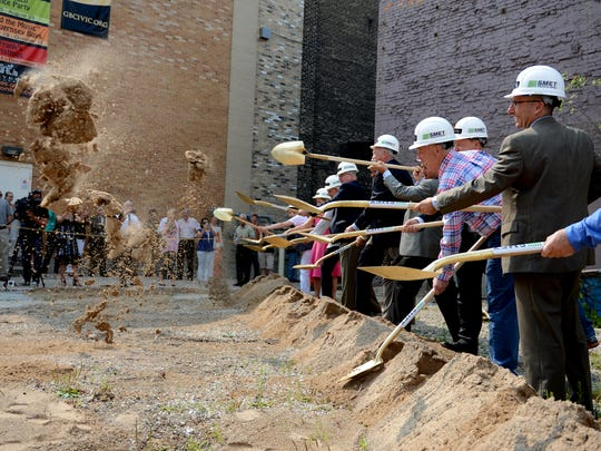 Officials break ground for the Meyer Theatre expansion project, Backstage at the Meyer, during Friday's ceremony.