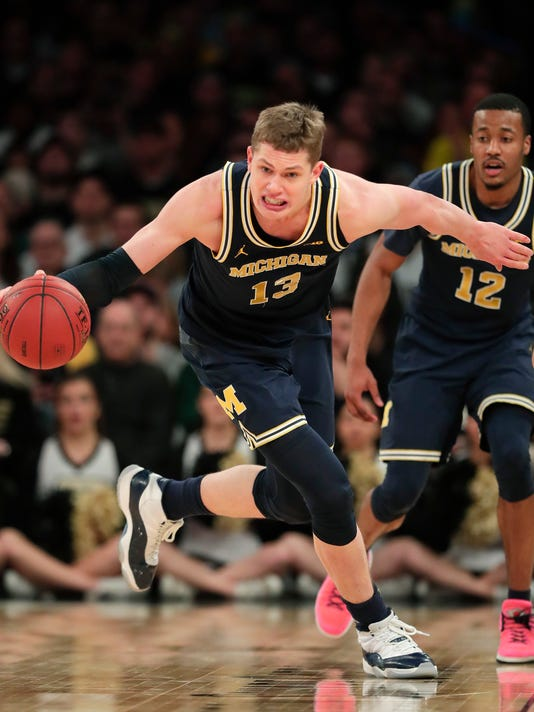 Michigan forward Moritz Wagner (13) makes a steal against Purdue during the second half of the NCAA Big Ten Conference tournament championship college basketball game, Sunday, March 4, 2018, in New York. Michigan won 75-66. (AP Photo/Julie Jacobson)