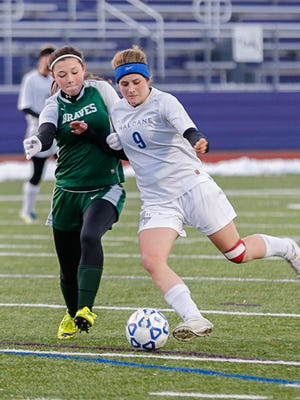 Haldane's Marina Martin going up against an Avon player, Cortland High School during the Class C state semifinal, Nov, 15, 2014.