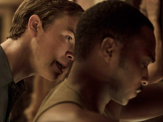 Will Poulter, left, and Anthony Mackie have an uneasy