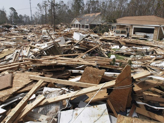 In this Aug. 31, 2005, file photo, remains of homes destroyed in Gulfport lie on a street on after Hurricane Katrina made landfall the day before.