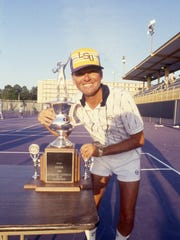 Jerry Simmons, shown here showing off a tournament trophy during his days as LSU's tennis coach, will be inducted into the Louisiana Sports Hall of Fame on Saturday, June 30 in Natchitoches.