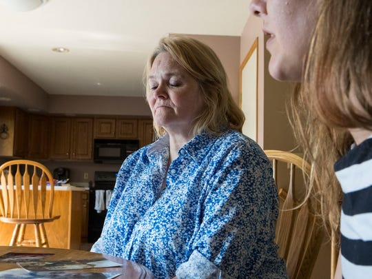 Shelley Johnson, Nick Laughlin's mother, looks at pictures of him at her house in Sioux Falls, S.D. Tuesday, July 3, 2018.
