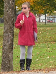 Olivia LaMothe, 14, discreetly surveys adult motorists at Shelburne Community School as part of an anti-idling study by her eighth grade science class.