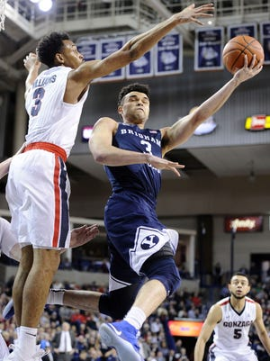 Brigham Young Cougars guard Elijah Bryant (3) goes up for a basket against Gonzaga Bulldogs forward Johnathan Williams (3).