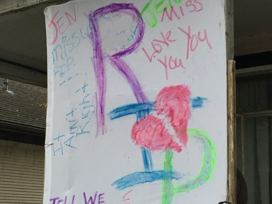 A poster remembers Jennie Lee Smith-Solorzano, who was killed in Sioux Falls.